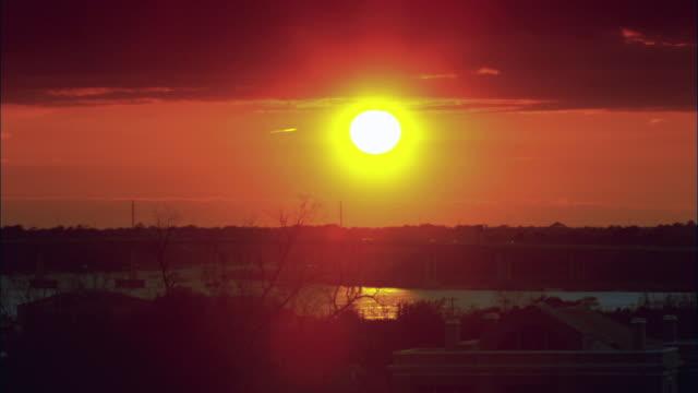 zi sun setting on the horizon / charleston, south carolina, united states - charleston south carolina stock videos & royalty-free footage