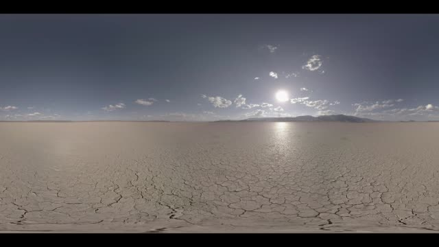 Sun setting over a dry desert floor