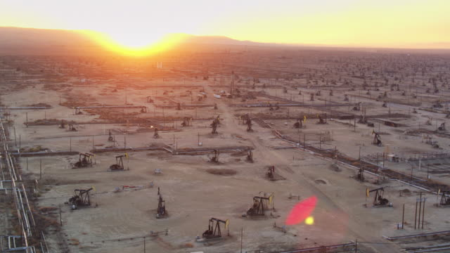 Sun Setting Over California Central Valley and South Belridge Oil Field - Drone Shot
