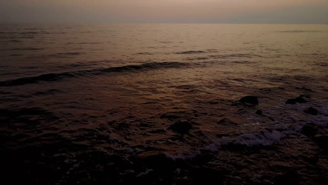 sun setting over calm waters off maui coastline - wide stock videos and b-roll footage