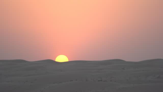 Sun setting over desert