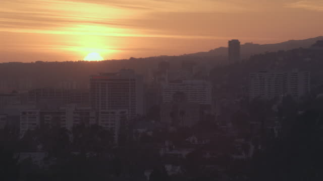 WS Sun setting over Hollywood Hills / California, United States