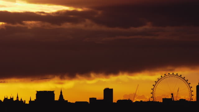 WS T/L Sun setting over Houses of Parliament London skyline / London, United Kingdom