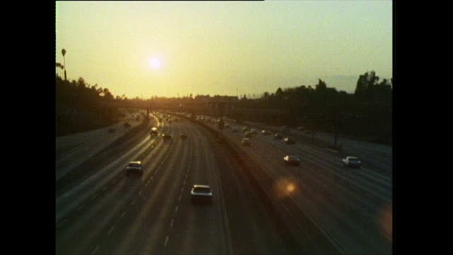 sun setting over interstate in los angeles; 1972 - motorway stock videos & royalty-free footage