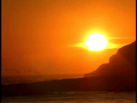 ms, sun setting over ocean, california, usa - stationary process plate stock videos & royalty-free footage