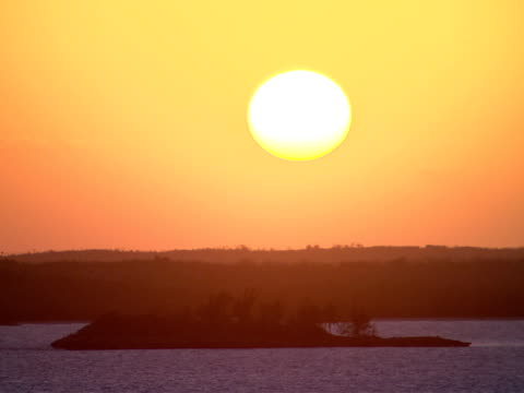 ms,  sun setting over sea coastline,  harbour island,  bahamas - stationary process plate stock videos & royalty-free footage