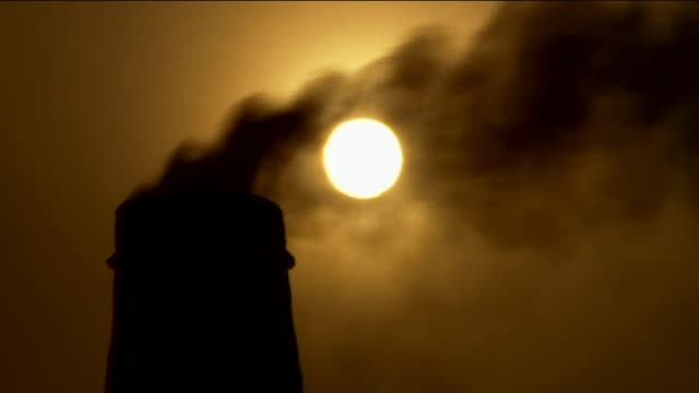 sun setting over two brick kiln labourers - kiln stock videos and b-roll footage