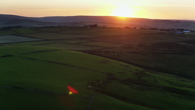 sun setting over upland farms in west yorkshire - twilight stock videos & royalty-free footage