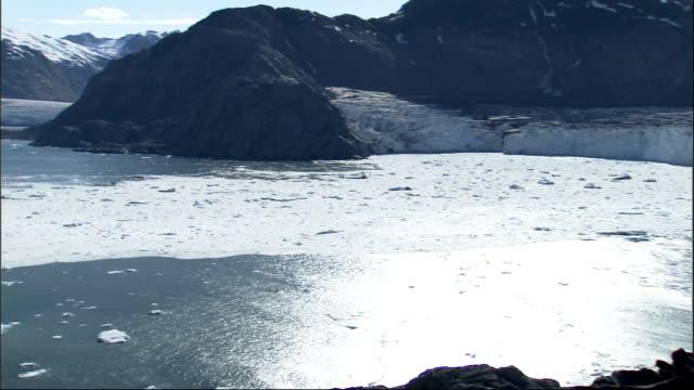 sun shines above a frozen bay near columbia glacier alaska. available in hd. - columbia glacier stock videos & royalty-free footage
