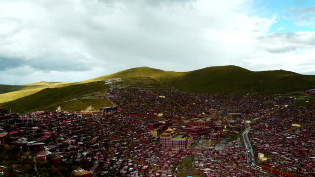 sun shines across the world's largest buddhist college - garze tibetan autonomous prefecture stock videos & royalty-free footage