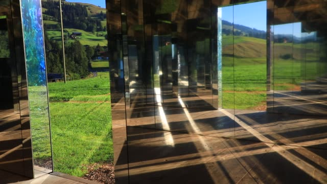 sun shines inside mirage gstaad by los angelesbased artist doug aitken is on display outside as installation sculpture representing a chalet made... - ski resort stock videos & royalty-free footage