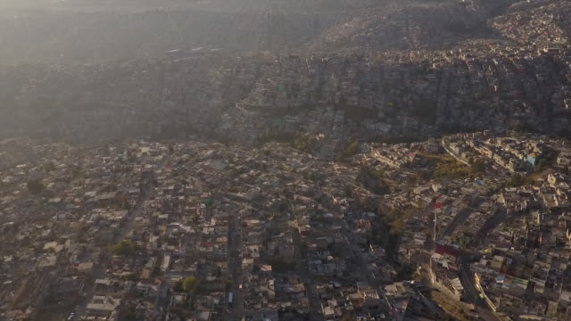 Sun shines on Mexico City, wide aerial