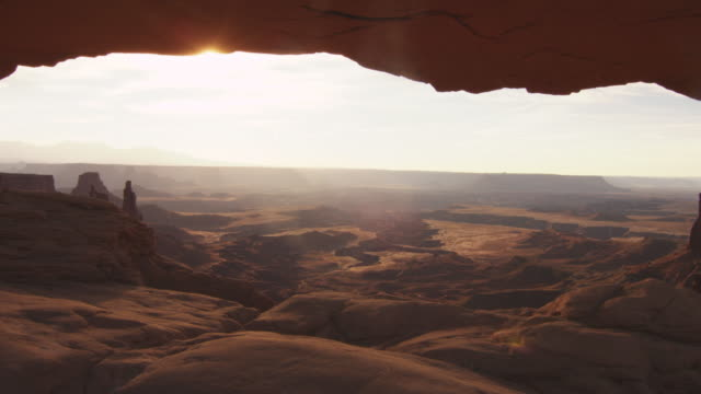 sun shines over arches national park, dolly shot - arches national park stock videos and b-roll footage