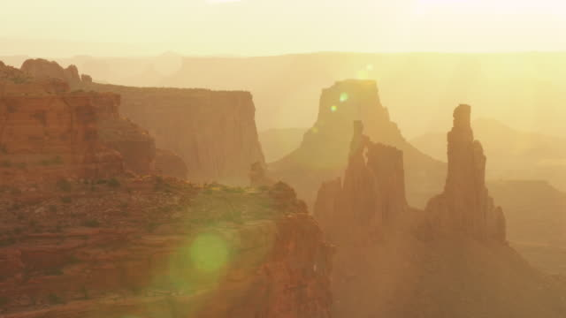 sun shines over canyon utah landscape, pan right - horizontal stock videos & royalty-free footage