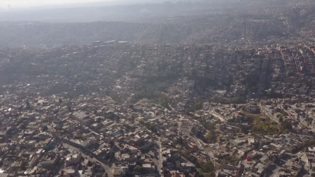 Sun shines over Mexico City skyline, aerial
