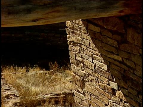 sun shines through a ruinous doorway of the casa rinconada in chaco canyon, new mexico. - chaco canyon stock videos & royalty-free footage