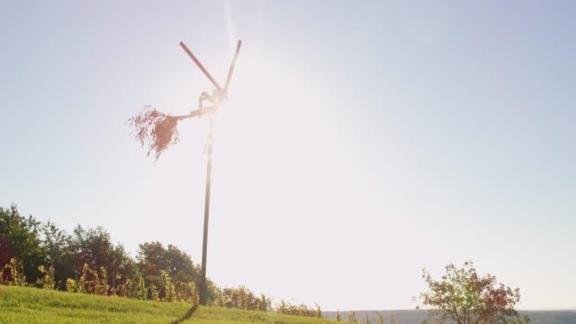 ms sun shining behind spinning windmill at sunny,rural vineyard,prekmurje,slovenia - prekmurje stock videos & royalty-free footage