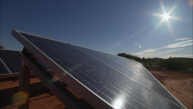 MS PAN Sun shining brightly down onto solar panels, Rainbow Valley, Northern Territory, Australia
