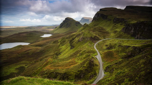 sun shining in the mountains of quiraing - isle of skye - scotland - mountain road stock videos & royalty-free footage