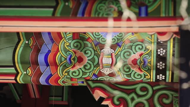 sun shining on 'dancheong' of songgwangsa temple / suncheon-si, jeollanam-do, south korea - moulding trim stock videos & royalty-free footage