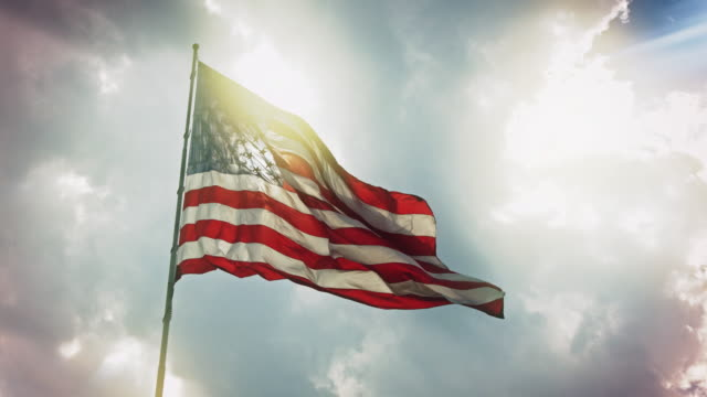 sun shining on us flag - stati uniti d'america video stock e b–roll