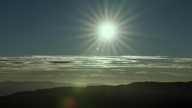 sun shining over a range of mountains, silhouetted. - basin and range province stock videos and b-roll footage