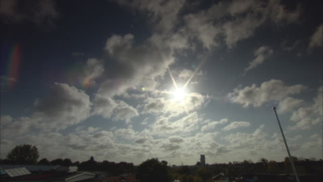 ws td sun shining over rooftops with rows of solar panels / malmo, sweden - malmo stock videos and b-roll footage