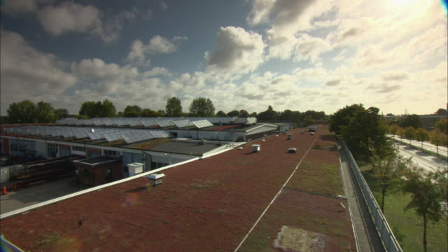 WS TU Sun shining over rooftops with rows of solar panels / Malmo, Sweden
