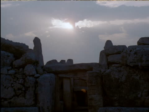 sun sinks behind ancient temple ruins mnajdra malta - obelisk stock videos & royalty-free footage