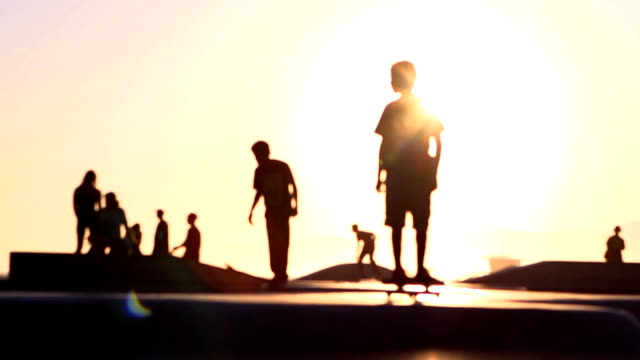 sun skateboard soft focus - venice california stock videos & royalty-free footage
