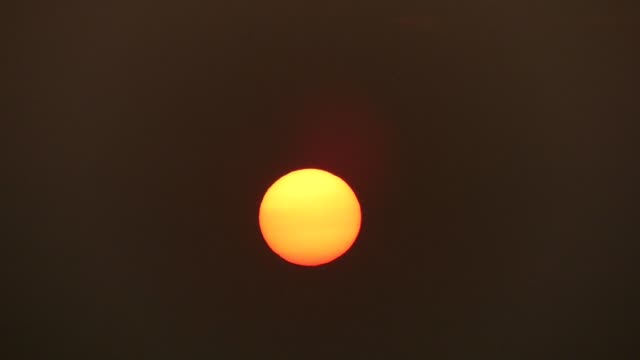 sun slowly goes down - atmosphere filter stock videos and b-roll footage
