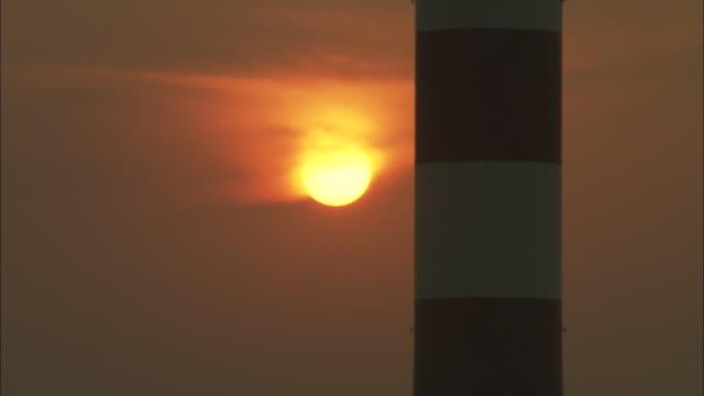 CU Sun slowly setting behind smokestack at Huaneng Yuhuan Power Plant, Yuhuan County, Zhejiang, China
