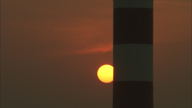 CU Sun slowly setting behind smokestack at Huaneng Yuhuan Power Plant, Yuhuan County, Zhejiang, China