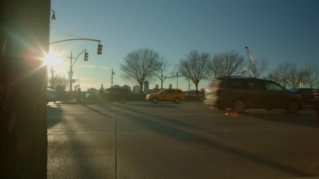Sun star road intersection New York City shilhouette