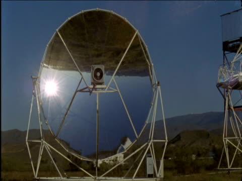 Sun tracks across surface of solar dish Spain
