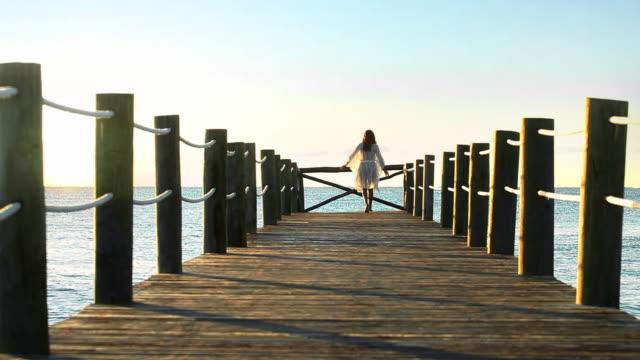 sun woman pier - mayan riviera stock videos & royalty-free footage