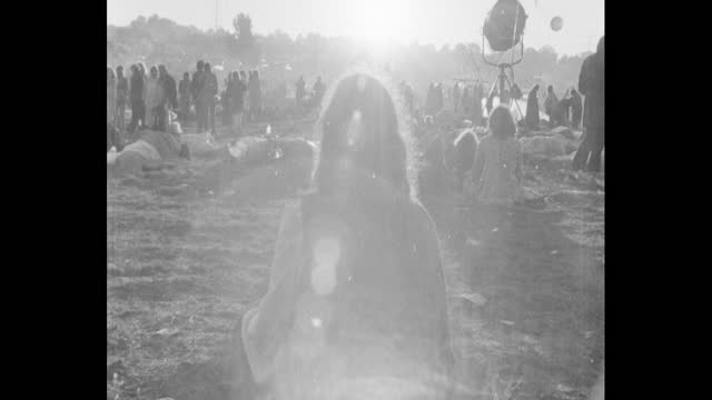 sun worshippers at 1971 glastonbury festival on worthy farm, pilton, during the summer solstice - hippy stock videos & royalty-free footage