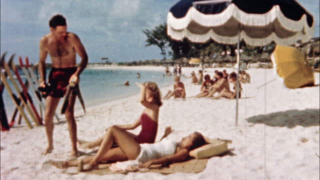 Sunbathers enjoy the white sands of a beach in Nassau, New Providence, Bahamas.