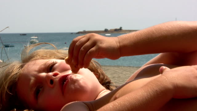 stockvideo's en b-roll-footage met sunbathing boy - 14 15 jaar