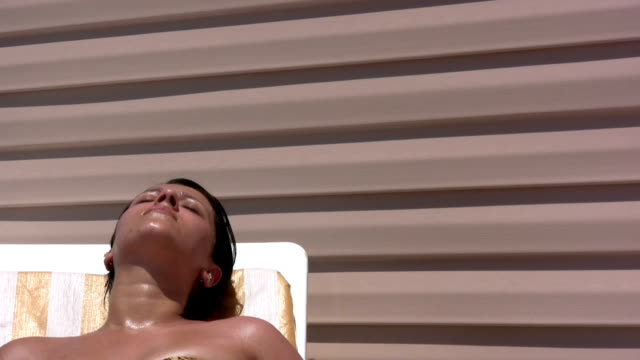 sunbathing - one piece swimsuit stock videos and b-roll footage