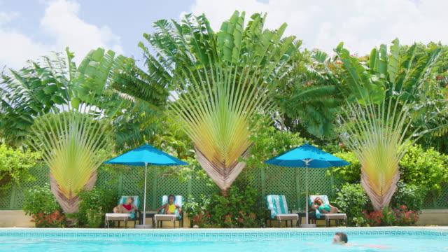 sunbathing - utebassäng bildbanksvideor och videomaterial från bakom kulisserna