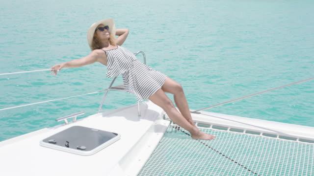 vídeos de stock e filmes b-roll de sunbathing - yacht