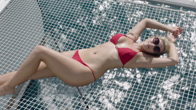 sunbathing - bikini stock-videos und b-roll-filmmaterial