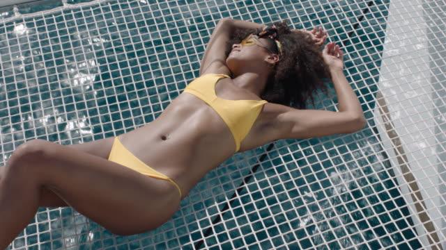 sunbathing - bikini stock videos & royalty-free footage