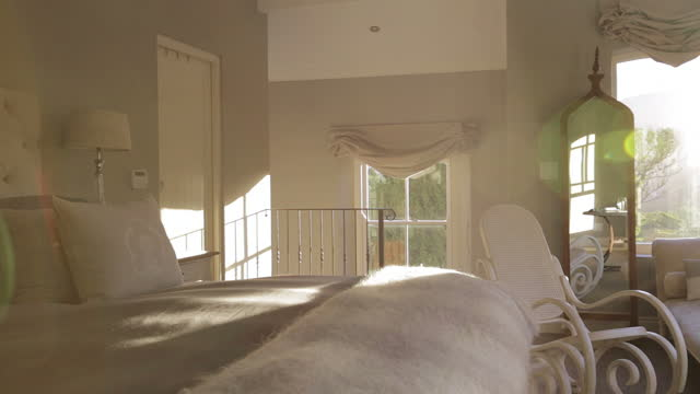 Sunbeam shining into luxury bedroom