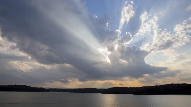 sunbeam through the growing clouds at the sunset - 陸地点の映像素材/bロール