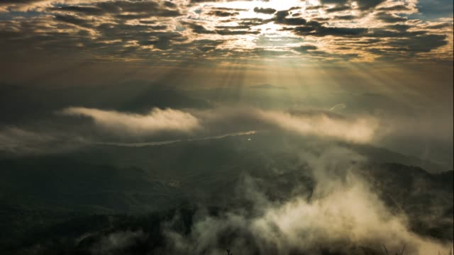 sunbeams and fog rolls across flowing over mountains - rainforest stock videos & royalty-free footage