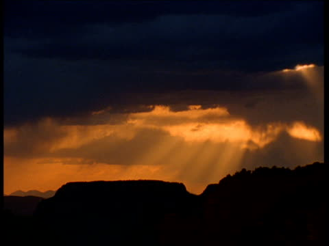 sunbeams drift and clouds billow over grand canyon at sunset, arizona - bbc stock videos and b-roll footage