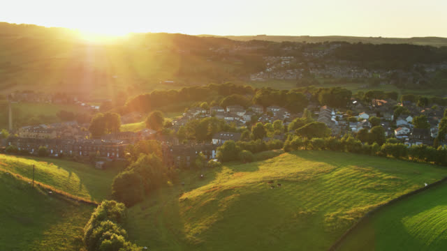 sunbeams on haworth, west yorkshire at sunset - aerial - twilight stock videos & royalty-free footage