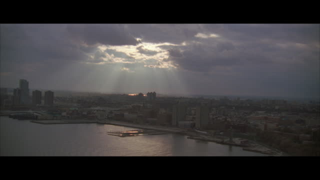 aerial, sunbeams over cityscape, jersey city, new jersey, usa - letterbox format stock videos & royalty-free footage